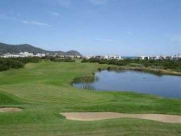 A view of a green with water coming into play at Cabo Negro Royal Golf Club